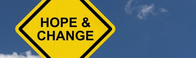Hope and Change Warning Sign Yellow warning road sign with word Hope and Change with sky background